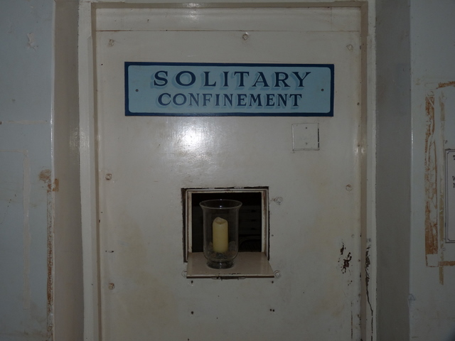 Photo of solitary confinement cell door